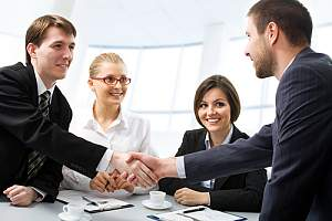 sales performance Consultant shaking a client hand