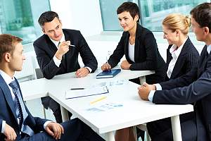 Consultant conducting sales training at a table