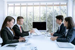 Sales team negotiating with client after receiving sales negotiating consulting services