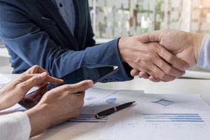 Sales team members shaking hands