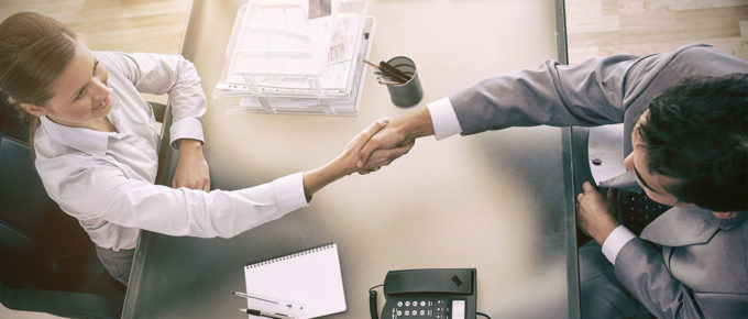 sales consulting firm shaking hands with new clients