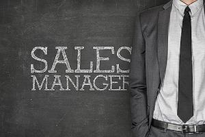 A man in business suit with sales manager written on the background. A concept for sales compensation consultant