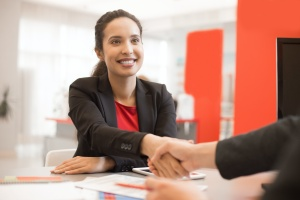 shaking hands with a Sales Program leader to help their sales