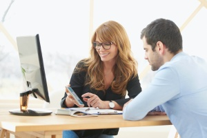 employee working with a Sales Compensation Consulting looking at computer