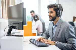 sales consultant taking calls after working with a sales compensation consulting