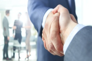 handshake after consultant working with a sales compensation consulting