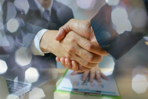 shaking hands after having deal for sales negotiation consulting